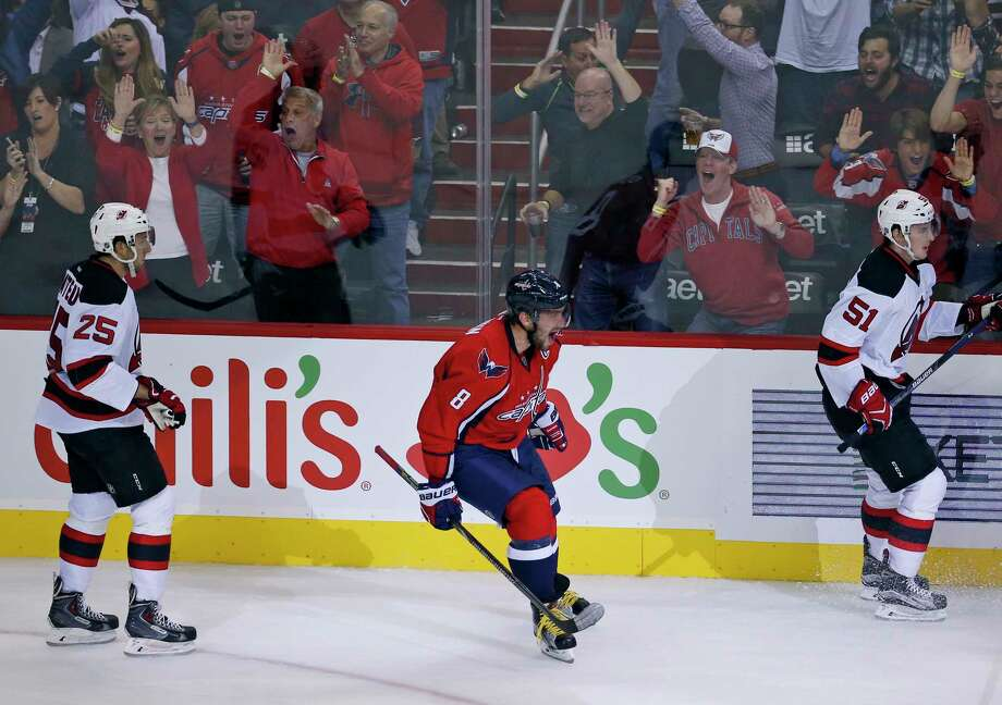 Capitals left wing Alex Ovechkin (8) celebrates his goal between New Jersey Devils centers Stefan Matteau (25) and Sergey Kalinin (51) during Saturday's game in Washington. Photo: Alex Brandon — The Associated Press  / AP