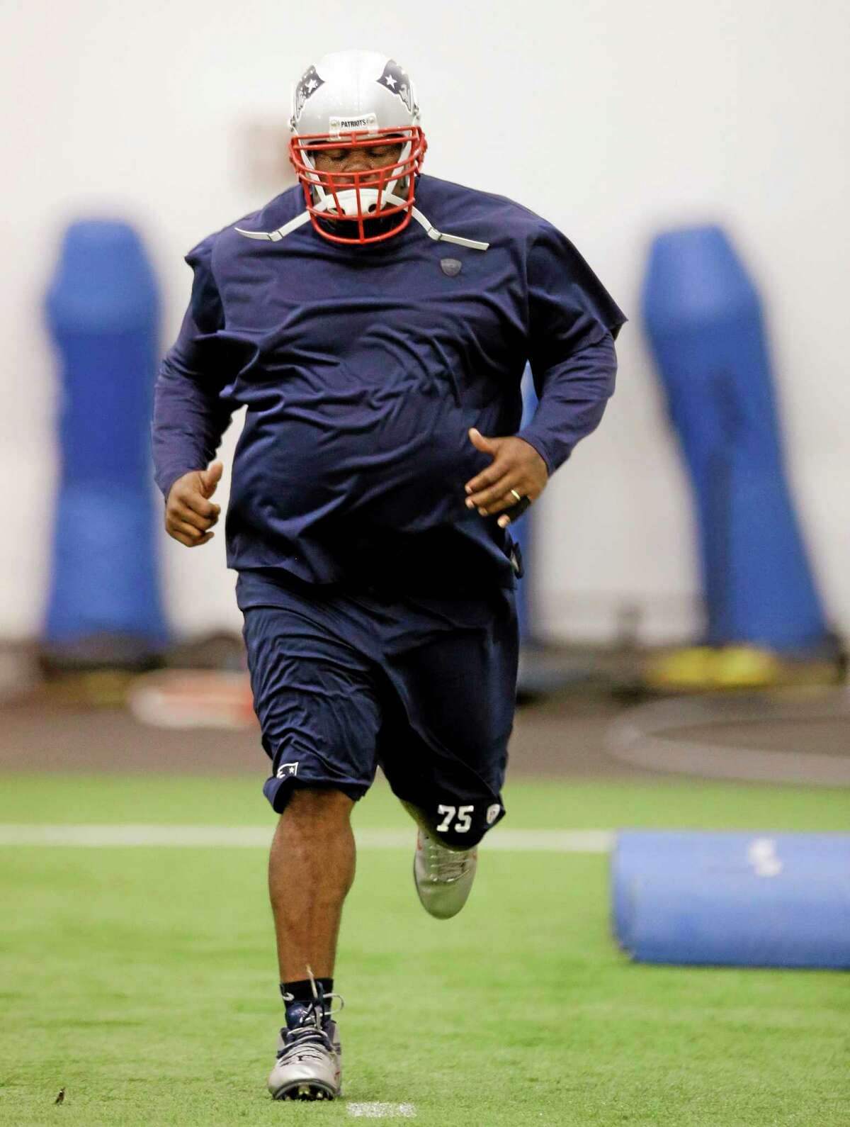 New England Patriots defensive lineman Vince Wilfork runs during minicamp at the team's indoor training facility Tuesday in Foxborough, Mass.