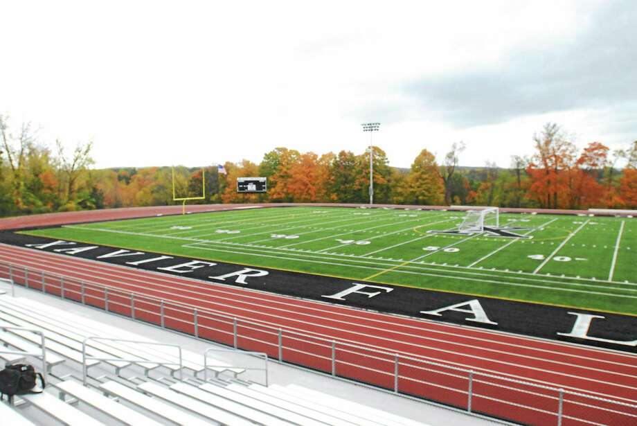 Jimmy Zanor - Middletown Press Xavier's new turf field will be dedicated prior to the Falcons Homecoming game against West Haven on Saturday at 12:30 p.m. It will be named Larry McHugh Field in honor of the founder of Xavier Football. McHugh coached Xavier from 1963 to 1983. The Falcons undefeated state championship team of 1974 will also be honored. Photo: Journal Register Co.
