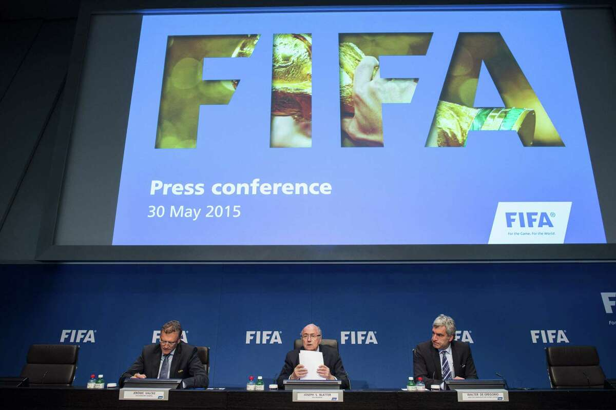In this May 30 file photo, FIFA President Sepp Blatter, center, speaks next to Jerome Valcke, FIFA Secretary General, left, and Walter De Gregorio, Director Communications and Public Affairs, right, during a news conference in Zurich, Switzerland.