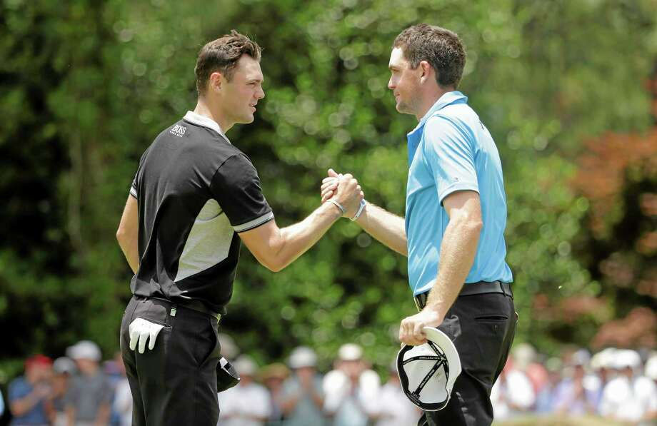 Eventual champion Martin Kaymer, left, shakes hands with Keegan Bradley after the second round of the U.S. Open on Friday in Pinehurst, N.C. Bradley shot a 4-under in the first round of the Travelers Championship on Thursday. Photo: Chuck Burton — The Associated Press  / AP