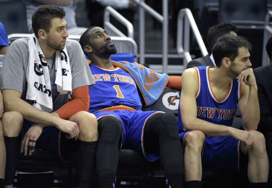 Amare Stoudemire, center, has agreed to a buyout from the Knicks. Photo: The Associated Press File Photo  / FR121174 AP