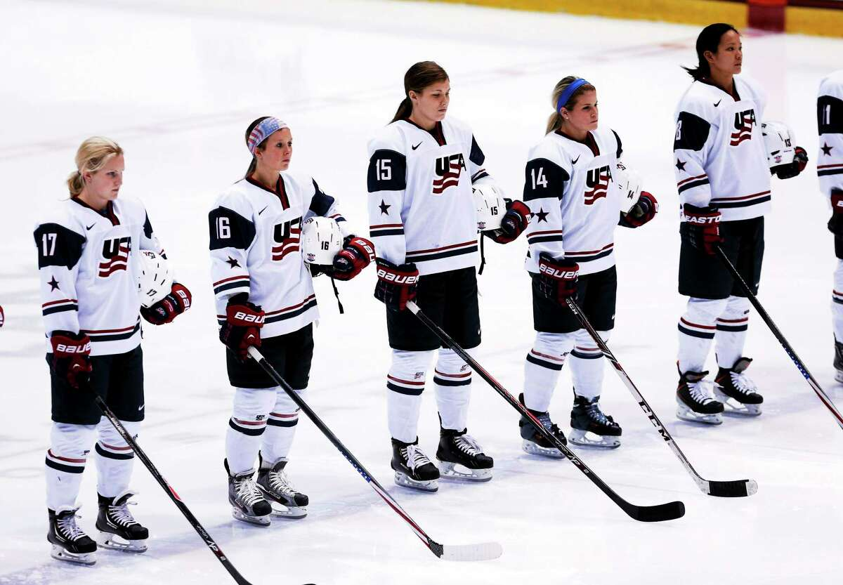 United States players Jocelyne Lamoureux (17), Kelli Stack (16), Anne Schleper (15), Brianna Decker (14) and Julie Chu (13) stand during the national anthems before a Four Nations Cup game against Sweden on Nov. 5 in Lake Placid, N.Y.