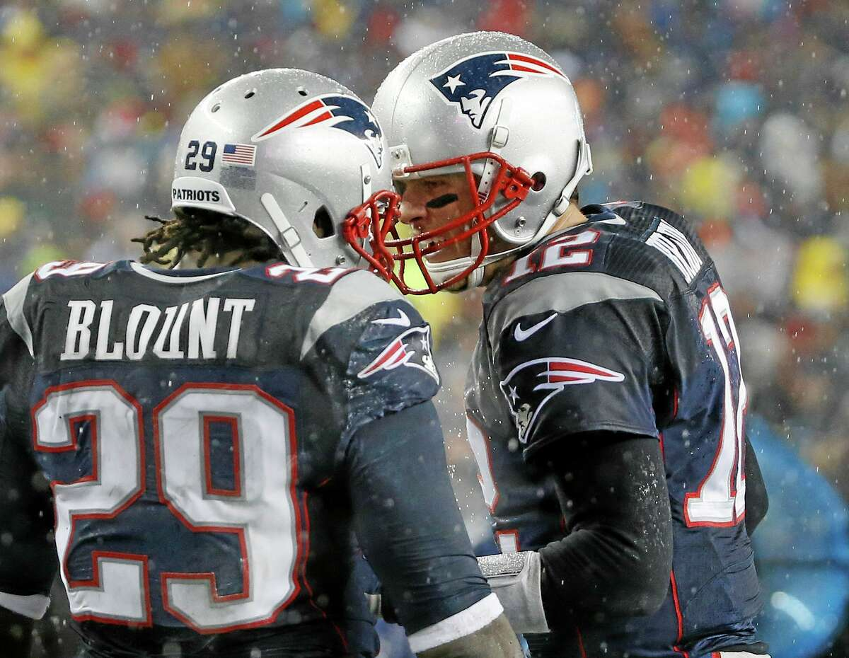 New England Patriots running back LeGarrette Blount (29) celebrates his touchdown with quarterback Tom Brady, right, in the second quarter of Sunday's game against the Buffalo Bills in Foxborough, Mass.