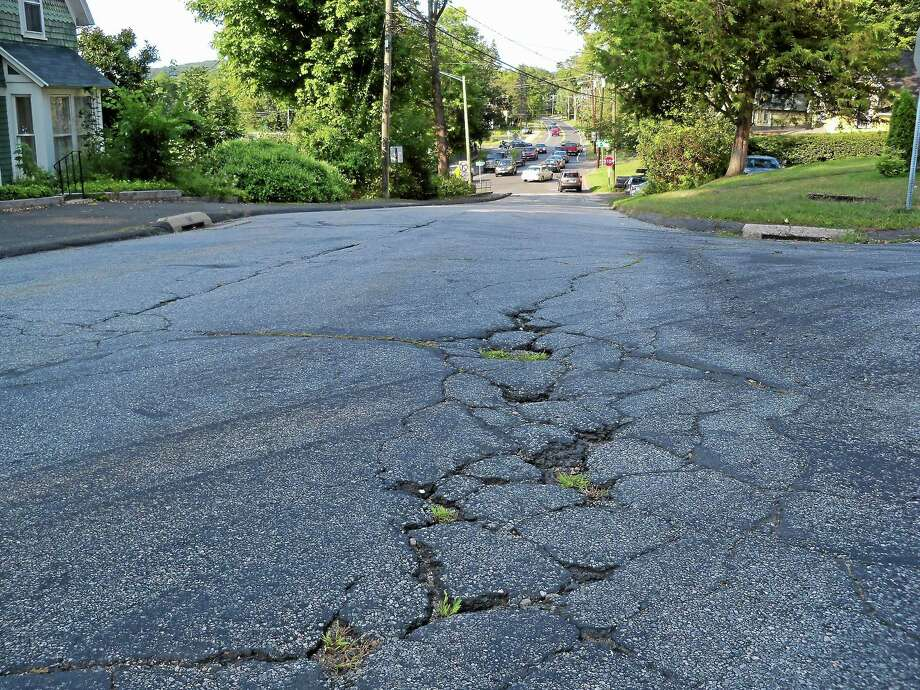 A dozen well-worn roads in Cromwell, including Arrowood Drive, Blackhaw Drive, Loquat Drive and Sequoia Drive, have been newly paved. Photo: File Photo