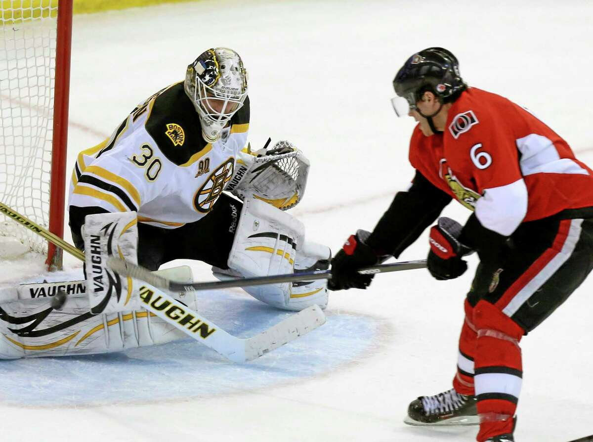 The Senators' Bobby Ryan scores a goal on Boston Bruins goaltender Chad Johnson during the third period of Saturday's game in Ottawa, Ontario.