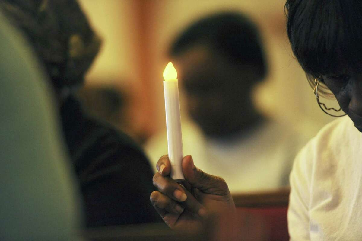 Parishioners gather during a vigil to mourn the lives lost at the shooting in Charleston, S.C., Thursday, June 18, 2015, at the Union Memorial A.M.E. Church in Benton Harbor, Mich. Dylann Storm Roof, 21, was arrested Thursday in the slayings of several people, including the pastor at a prayer meeting inside a historic black church. (Don Campbell/The Herald-Palladium via AP)