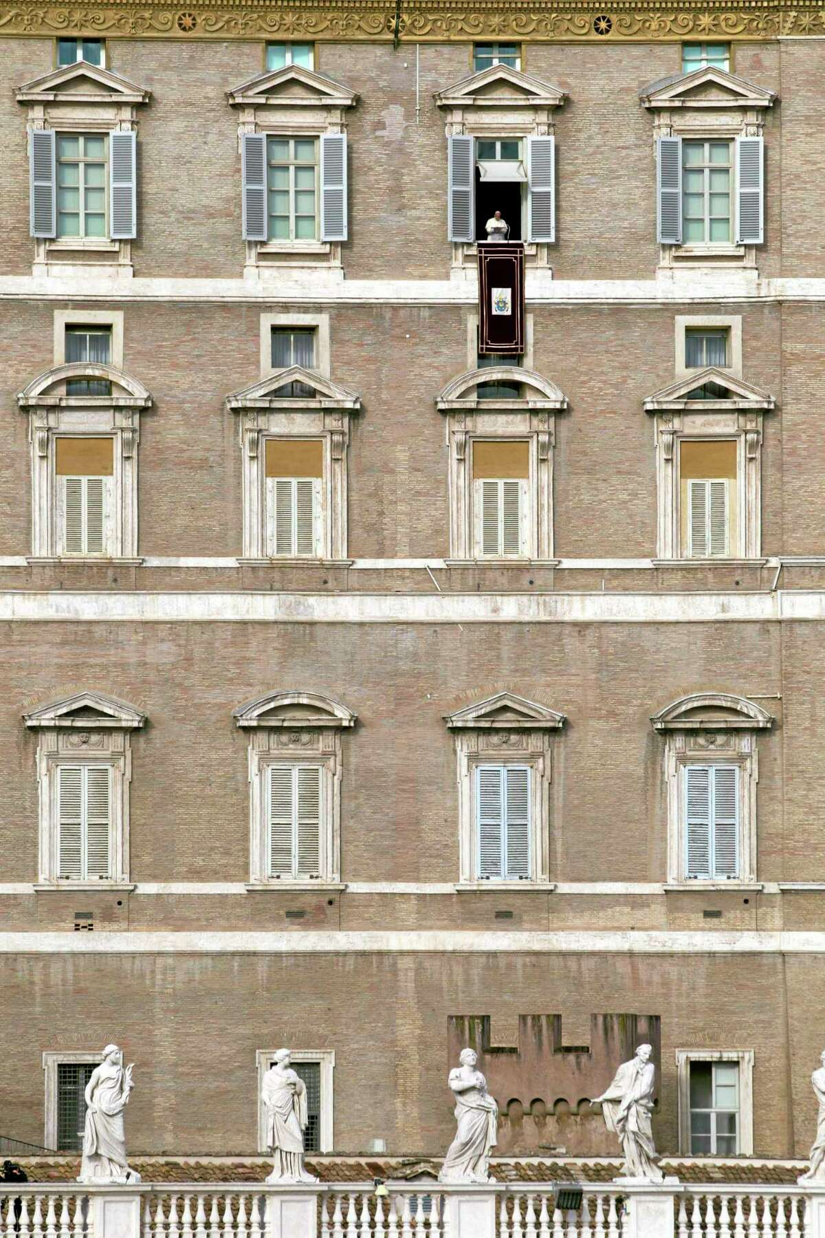 Pope Francis delivers his message during the Angelus noon prayer he celebrated from the window of his studio overlooking St. Peter's Square at the Vatican, Wednesday, Jan. 1, 2014.