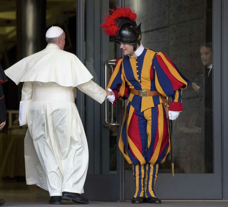 Pope Francis greets a Vatican Swiss Guard as he arrives for a morning session of a two-week synod on family issues, at the Vatican, Thursday, Oct. 16, 2014. (AP Photo/Alessandra Tarantino) Photo: AP / AP