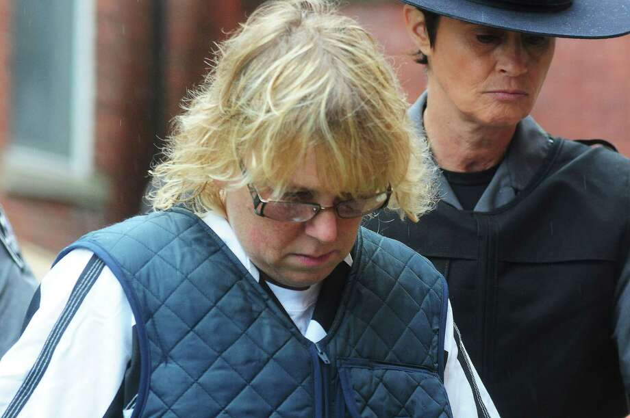 Joyce Mitchell heads into Plattsburgh City Court for her hearing, Monday, June 15, 2015, in Plattsburgh, N.Y. Mitchell is charged with helping convicted murderers Richard Matt and David Sweat escape from Clinton Correctional Facility. (Rob Fountain/Press-Republican via AP) Photo: AP / Press-Republican