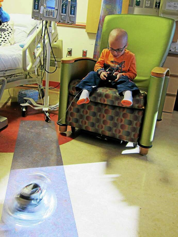 Judah Kanter, 6, of Rockville, Md., plays with a toy at Childrenís National in Washington, where heís being treated for leukemia. His father is a doctor there. Illustrates CANCER-COMMENT (category k), by John Kelly (c) 2013, The Washington Post. Moved Tuesday, Dec. 31, 2013. (MUST CREDIT: Washington Post photo by John Kelly) Photo: The Washington Post / The Washington Post