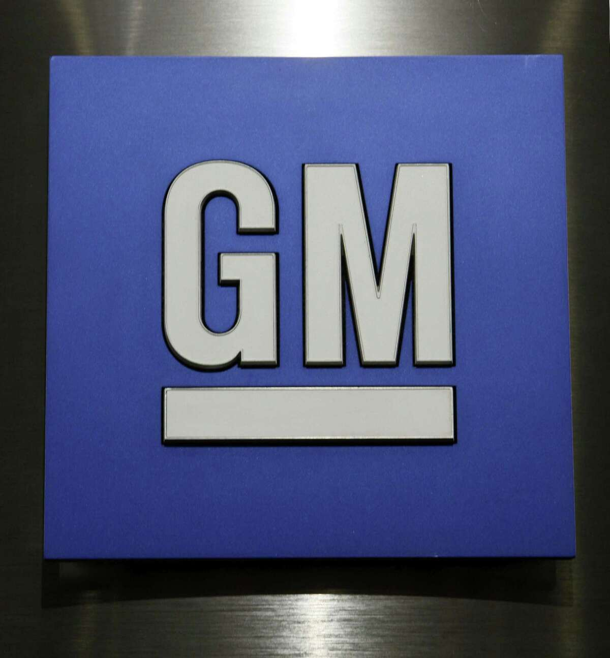 General Motors Co. logo is shown during a news conference in Detroit on Feb. 4, 2015.
