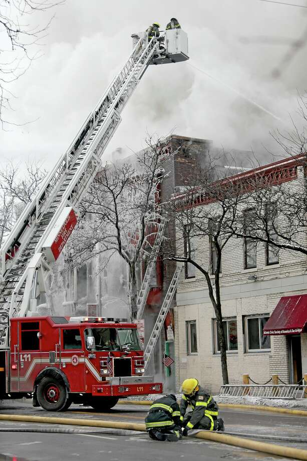 Firefighters work the scene where a fire engulfed several apartment units in the Cedar Riverside neighborhood, in Minneapolis, Wednesday, Jan. 1, 2014. Authorities say at least 13 people have been hurt. (AP Photo/Star Tribune, Elizabeth Flores) Photo: AP / Star Tribune