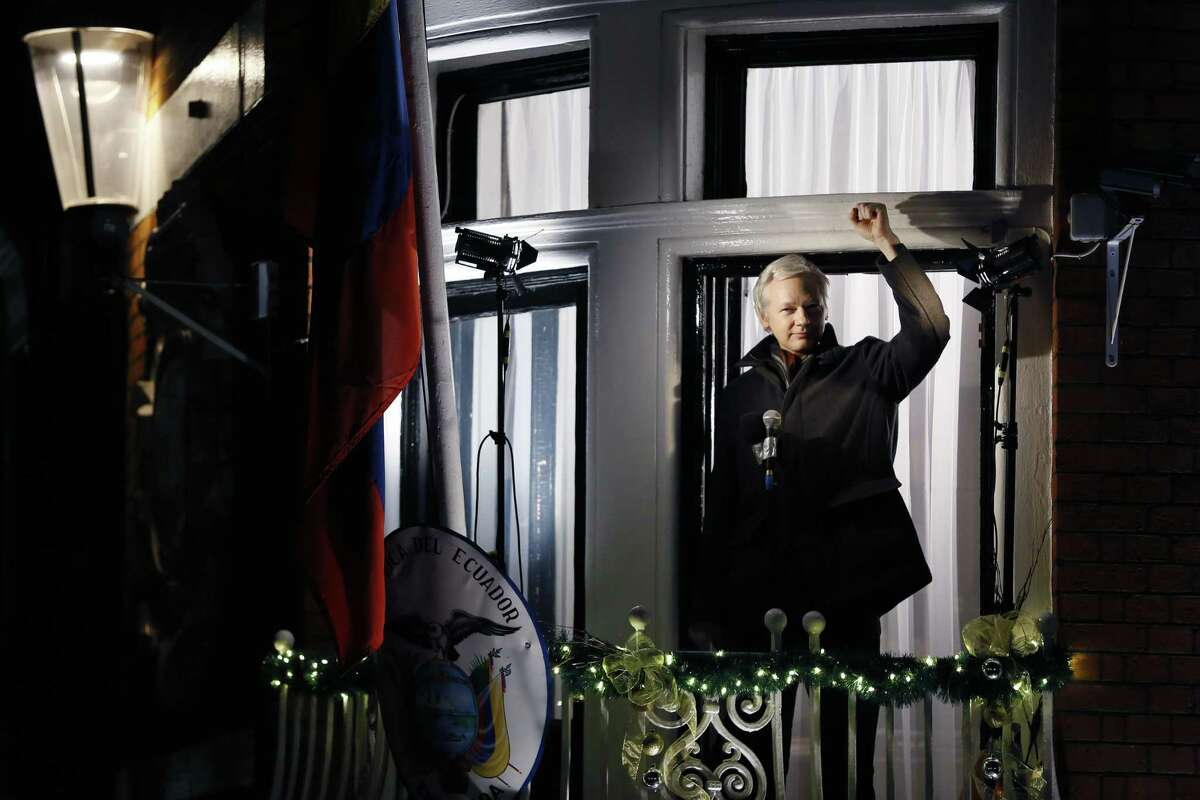FILE - In this Thursday, Dec. 20, 2012 file photo, Julian Assange, founder of WikiLeaks gestures as he speaks to the media and members of the public from a balcony at the Ecuadorian Embassy in London, Thursday, Dec. 20, 2012. Julian Assange is marking the third anniversary of his stay inside Ecuador's London embassy. The WikiLeaks founder entered the building on June 19, 2012, to avoid extradition to Sweden for questioning about alleged sexual assaults. (AP Photo/Kirsty Wigglesworth, File)