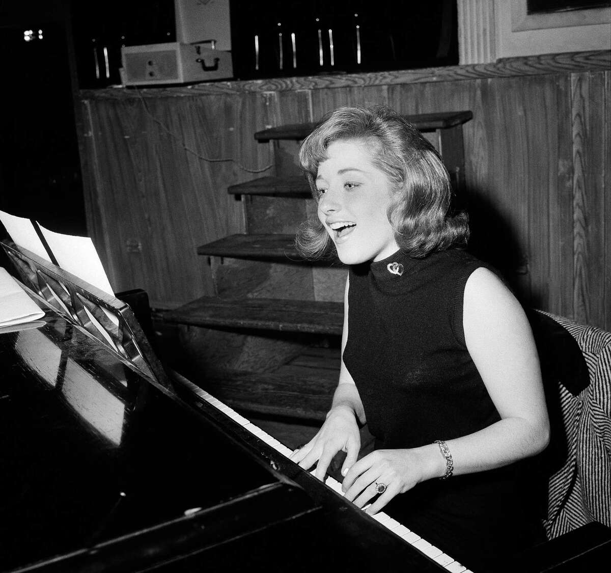 In this Jan. 5, 1966 file photo, singer Lesley Gore rehearses at a piano, in New York.