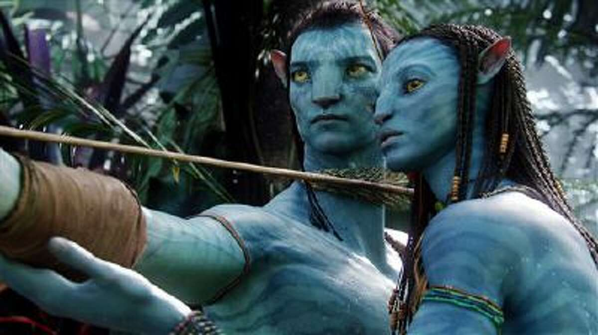 This undated file film publicity image originally released by 20th Century Fox shows the characters Neytiri, voiced by Zoe Saldana, right, and Jake, voiced by Sam Worthington, in a scene from