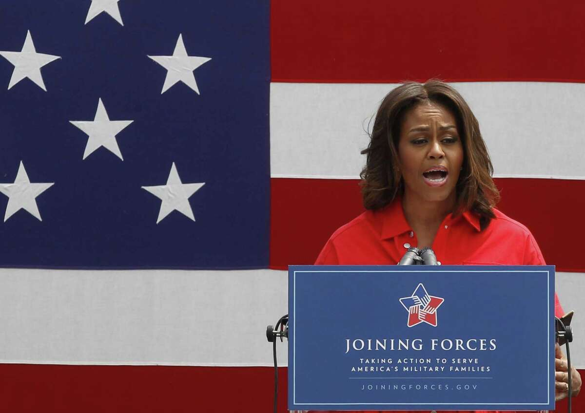 U.S. first lady Michelle Obama gives a speech as she arrives to meet with soldiers and their families at the U.S. Army Garrison Vicenza, northern Italy, Friday, June 19, 2015. Michelle Obama, who is visiting Italy on the second leg of a European trip, thanked the U.S. soldiers and their families for their service. (AP Photo/Antonio Calanni)