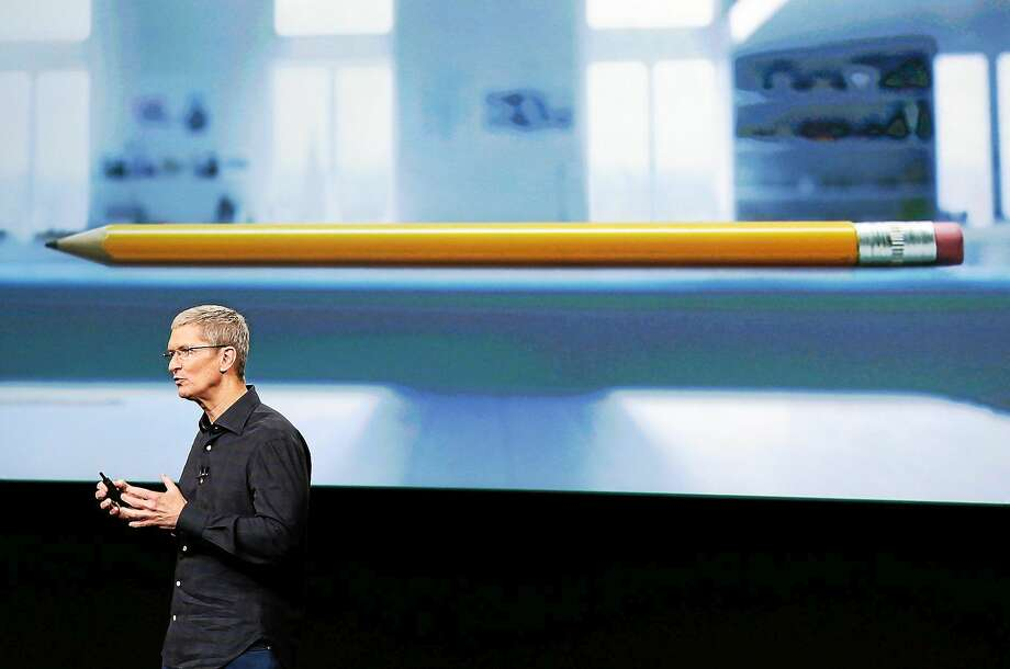 Apple CEO Tim Cook introduces the new Apple iPad Air 2 during an event at Apple headquarters on Oct. 16, 2014 in Cupertino, Calif. Photo: AP Photo/Marcio Jose Sanchez  / AP