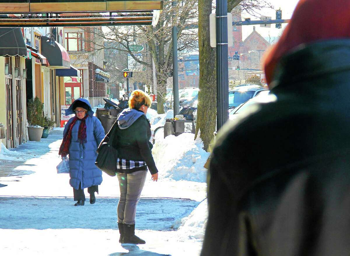Folks bundle up against frigid temperatures on Main Street in Middletown on Monday.