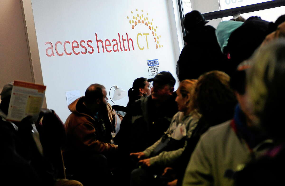People wait to sign up for health coverage at Access Health CT on March 31, 2014, in New Britain, Conn.