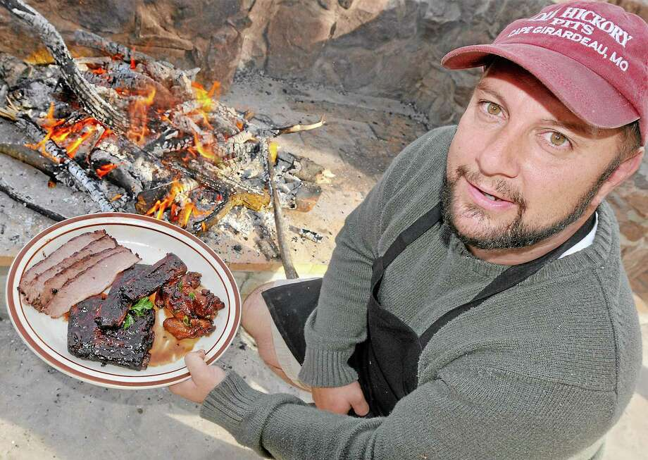 Middletown resident Chris Szewczyk, shown in this file photo, is owner of Taino Smokehouse at 482 South Main Street in Middletown. Photo: Catherine Avalone — The Middletown Press   / TheMiddletownPress