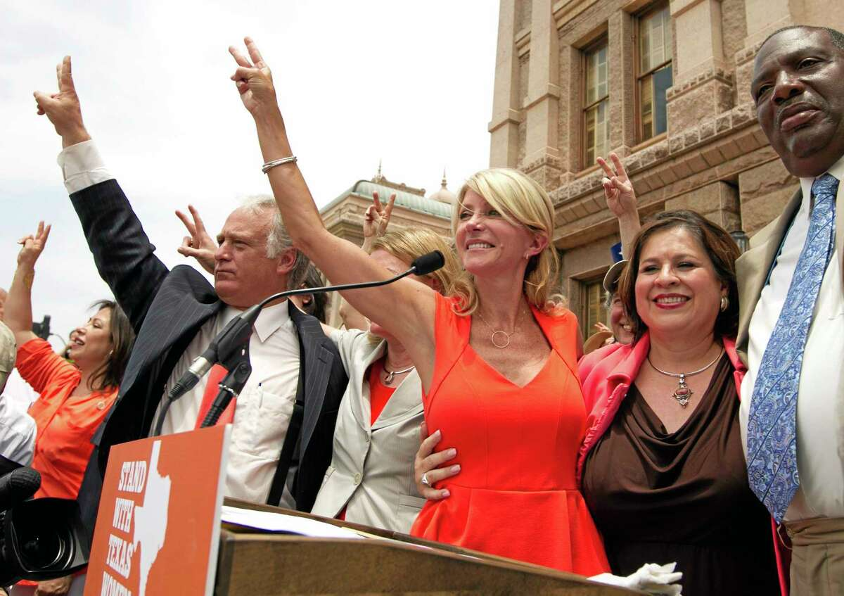FILE - In this July 1, 2013, file photo, Democratic state senators, from left, Kirk Watson, Wendy Davis, Leticia Van de Putte and Royce West participate in a pro-abortion rights rally at the state Capitol in Austin, Texas. Davis and Van de Putte are going for a new kind of history in the U.S.: Winning as an all-female ticket for governor and lieutenant governor. The two Democrats may carry the best odds yet in their run in Texas: If they prevail in their March primaries as expected, political experts say, it would be only the fifth time in at least 20 years that a party has nominated women for both governor and lieutenant governor. (AP Photo/Statesman.com, Jay Janner, File)