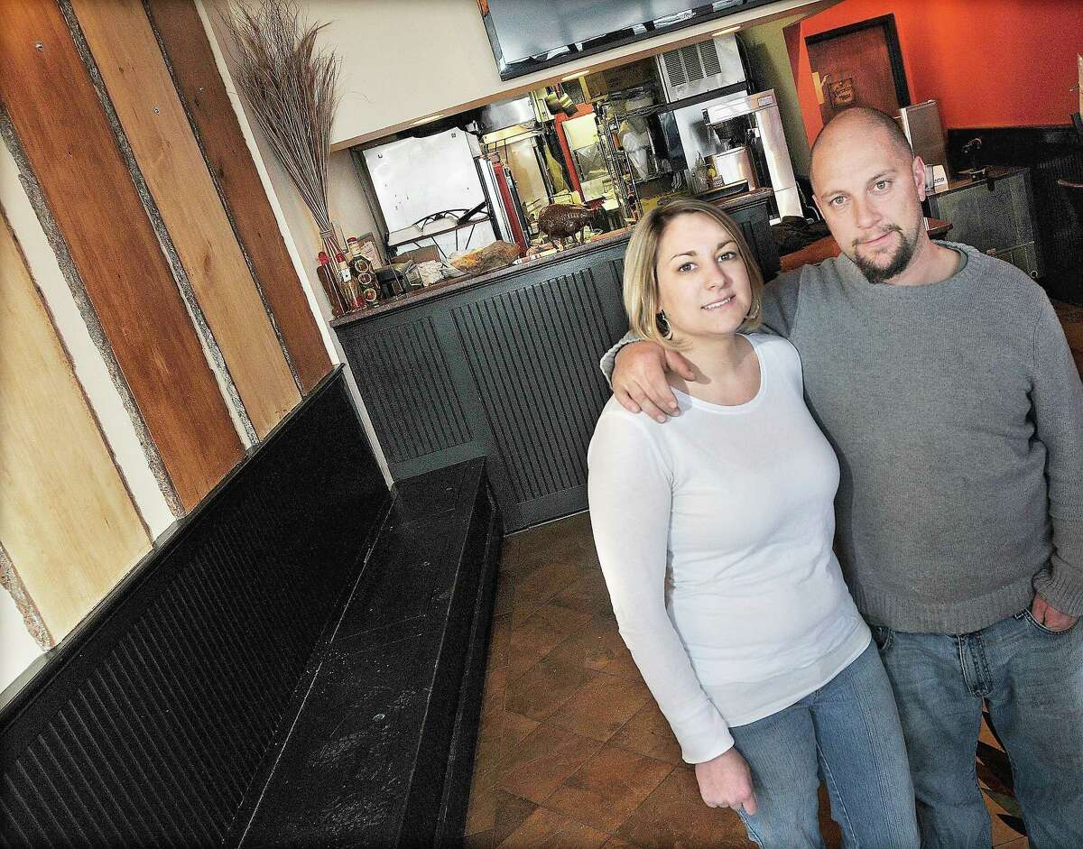 Chris and Jenny Szewczyk, shown in this file photo, own Taino Smokehouse at 482 South Main Street, next to Ace Hardward in Middletown. The couple hosted the first Indigenous People's Day BBQ Cook-off State Championship on Oct. 10-11.