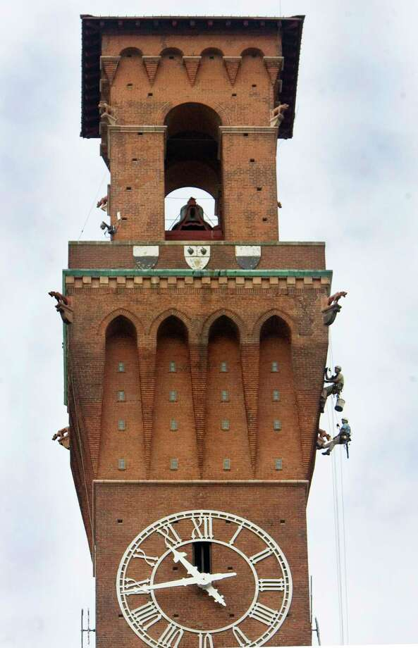 Workers descend down the Republican-American's clock tower to investigate the condition of each face of the 240-foot-tall structure in Waterbury, Conn. Thursday June 18th 2015. The results of their inspection will be used to design repairs to the 109-year-old clock tower.  (Steven Valenti/The Republican-American via AP) MANDATORY CREDIT Photo: AP / Republican-American