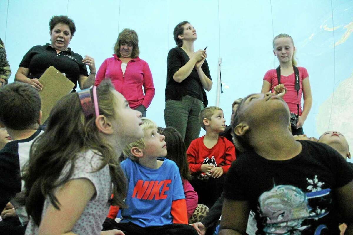 Vivian McRae Wesley Elementary School students in all grades took part in Earth Adventure's presentation Thursday in Middletown, including the program's highlight when students enter the earth balloon.