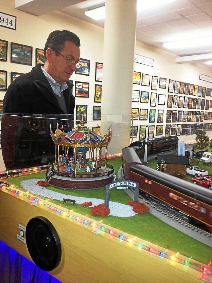 Gov. Dannel Malloy visits Amato's Toy and Hobby shop in Middletown and its extensive electric train display Monday. Photo: Mary O'Leary — New Haven Register