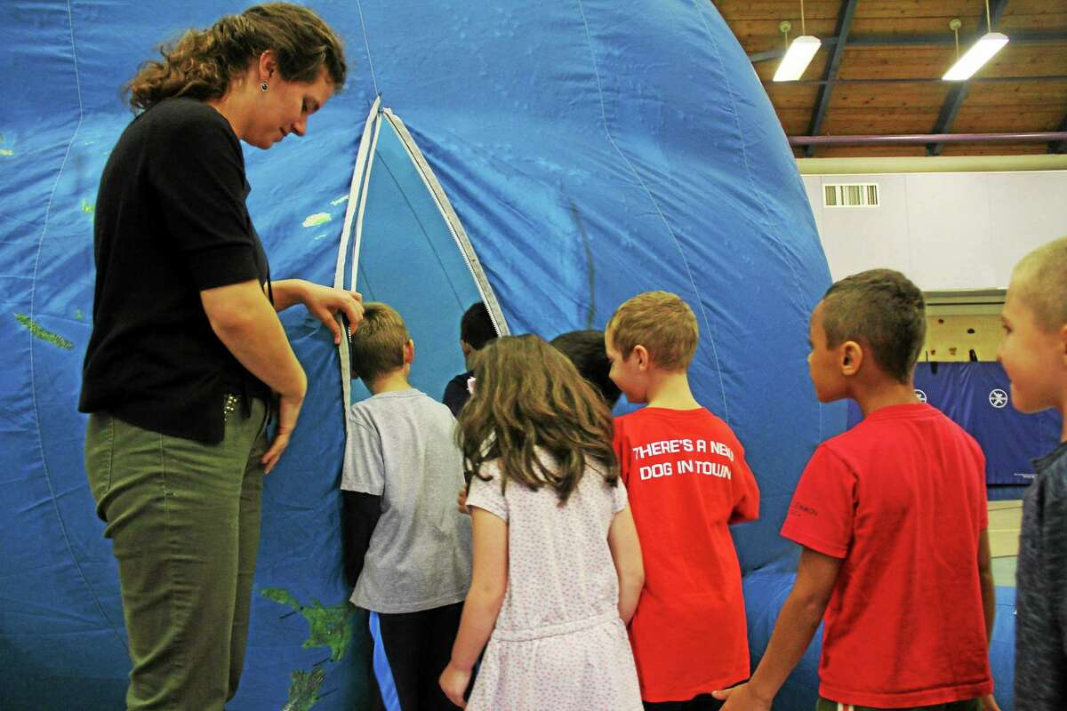 Kathleen Schassler/Middletown Press Wesley students in all grades took part in Earth Adventure's presentation, including the program's highlight when students enter the earth balloon.
