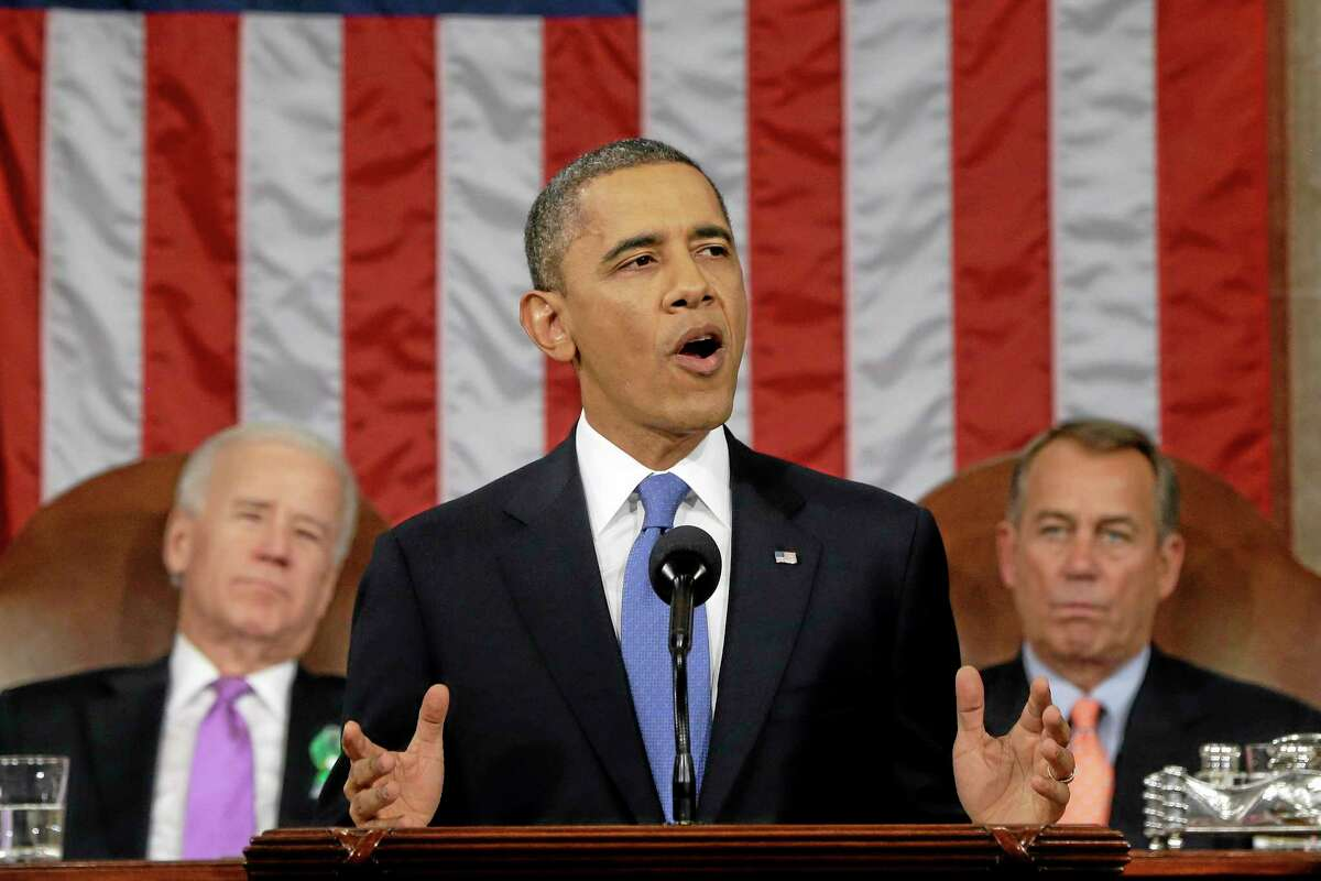 FILE - This Feb. 12, 2013 file photo shows President Barack Obama, flanked by Vice President Joe Biden and House Speaker John Boehner of Ohio, giving his State of the Union address during a joint session of Congress on Capitol Hill in Washington. It was a moment for Barack Obama to savor. His second inaugural address over, Obama paused as he strode from the podium last January, turning back for one last glance across the expanse of the National Mall, where a supportive throng stood in the winter chill to witness the launch of his new term.