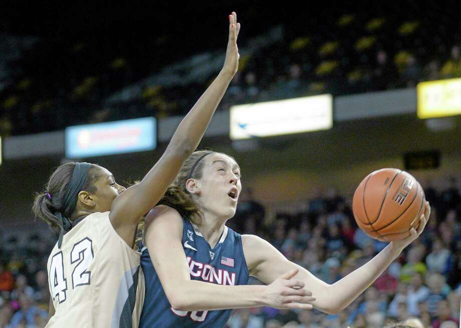 UConn forward Breanna Stewart goes up for a shot while Central Florida forward Stephanie Taylor defends during the first half of the top-ranked Huskies' 77-49 win on Wednesday in Orlando, Fla. Photo: Phelan M. Ebenhack — The Associated Press  / FR121174 AP
