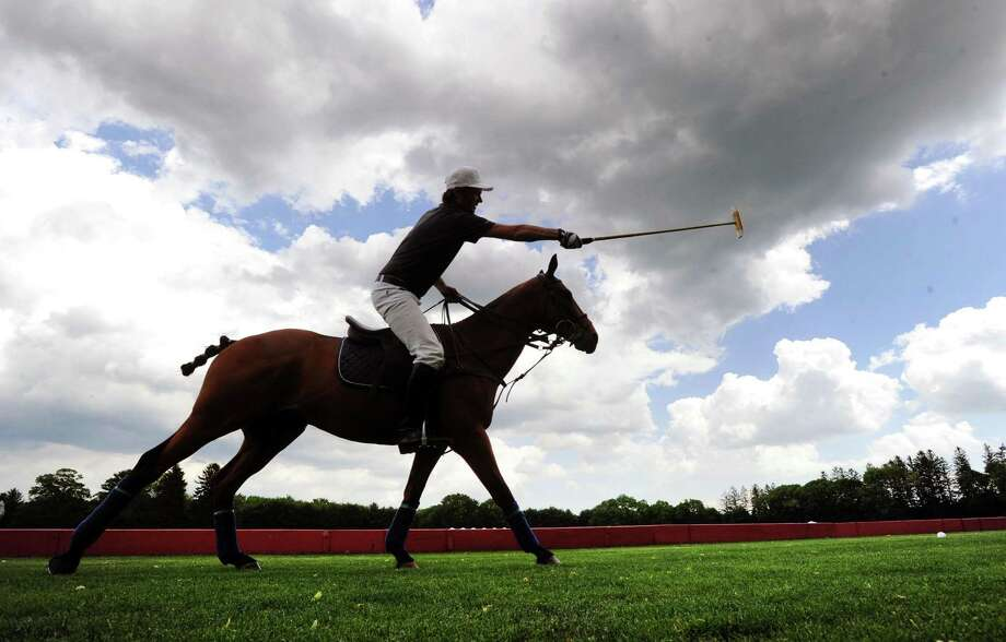 Polo player Nick Manifold on his horse Chimango in action at the Greenwich Polo Club June 1, 2017. The 2017 East Coast Open will run from Aug. 24 through Sept. 10, and organizers expect that the three consecutive Sunday competitions will draw more than 11,000 spectators to Greenwich Polo Club. Photo: Bob Luckey Jr. / Hearst Connecticut Media / Greenwich Time