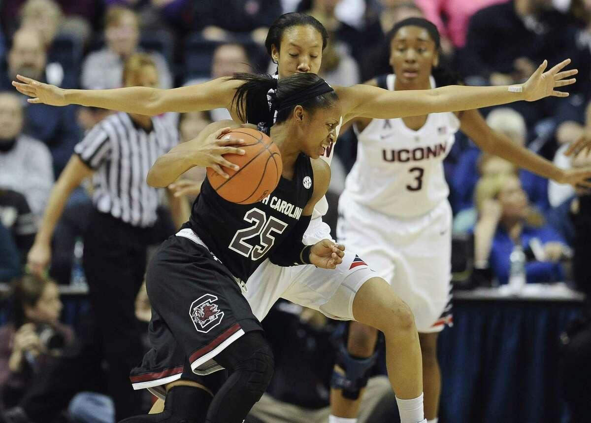 UConn's Saniya Chong defends South Carolina's Tiffany Mitchell during their game on Feb. 9.