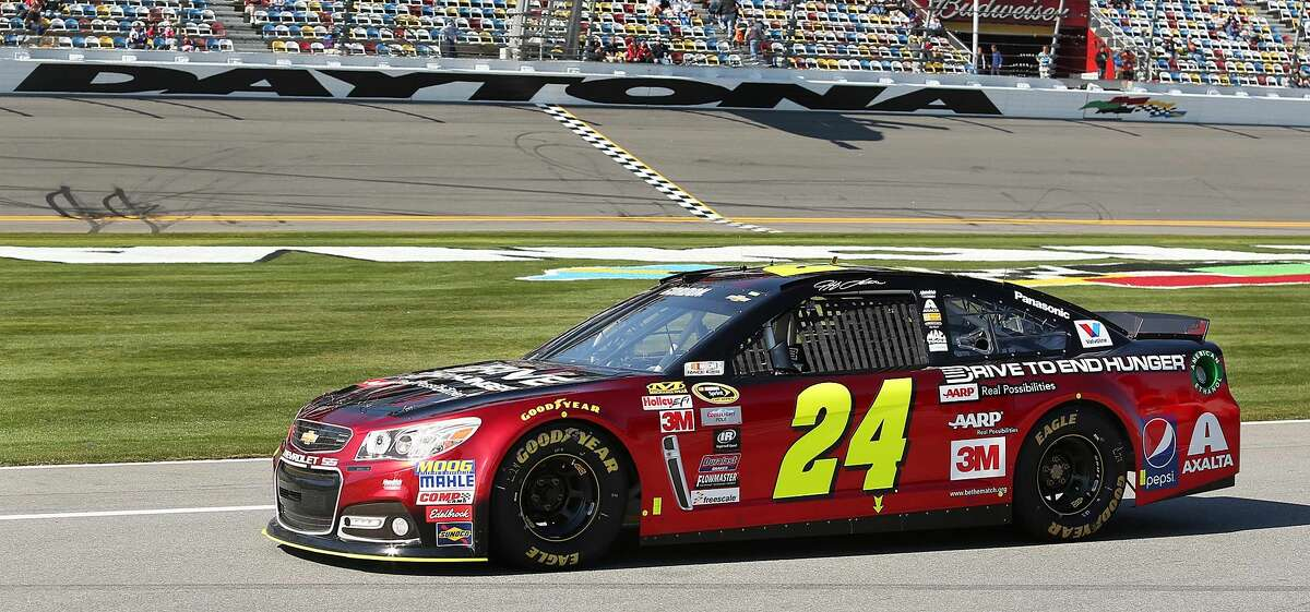 Jeff Gordon drives down pit road during qualifying for the Daytona 500 on Sunday.