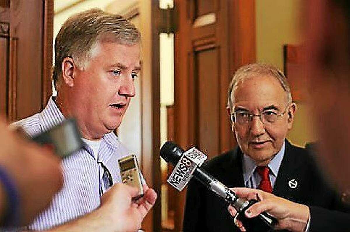 House Speaker Brendan Sharkey and Senate President Martin Looney leave Gov. Malloy's office