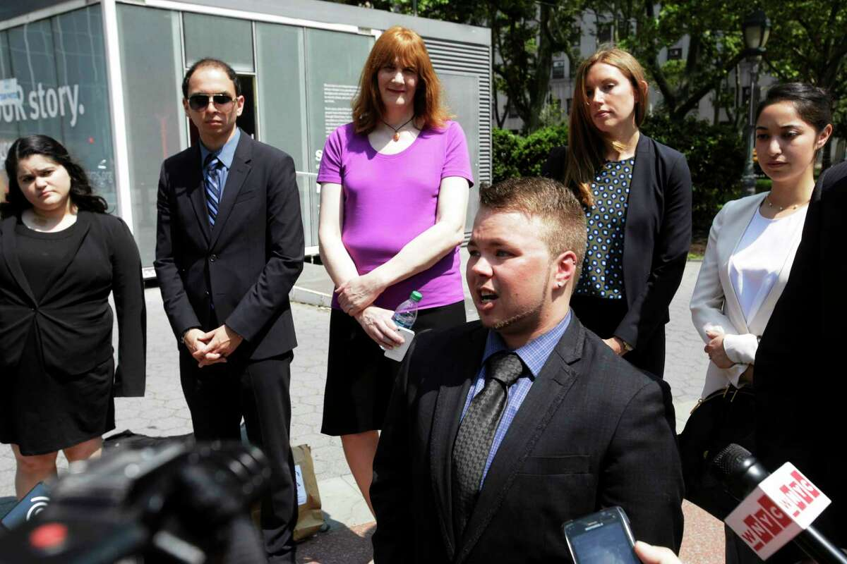 Bryan Ellicott speaks at a news conference, Tuesday, June 3, 2014 in New York. The transgender man has sued New York City after he says he was booted from a male locker room at a public pool in Staten Island. He says a staff member ordered him to use the women's locker room. (AP Photo/Mark Lennihan)