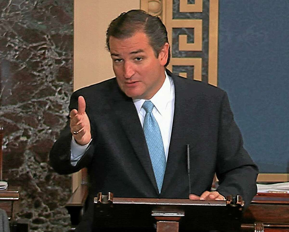 FILE - This Sept. 24, 2013, file image from Senate video show Sen. Ted Cruz, R-Texas, speaking on the Senate floor at the U.S. Capitol in Washington. Call it a steady diet of gridlock, with Green Eggs and Ham on the side. Congress did not pass White House-backed immigration or gun control legislation in 2013. Or raise the minimum wage. Or approve many other items on President Barack Obamaís agenda. But tea party-inspired House Republicans did propel the country into a 16-day partial government shutdown that cost the still-recovering economy $24 billion by one estimate. (AP Photo/Senate TV)