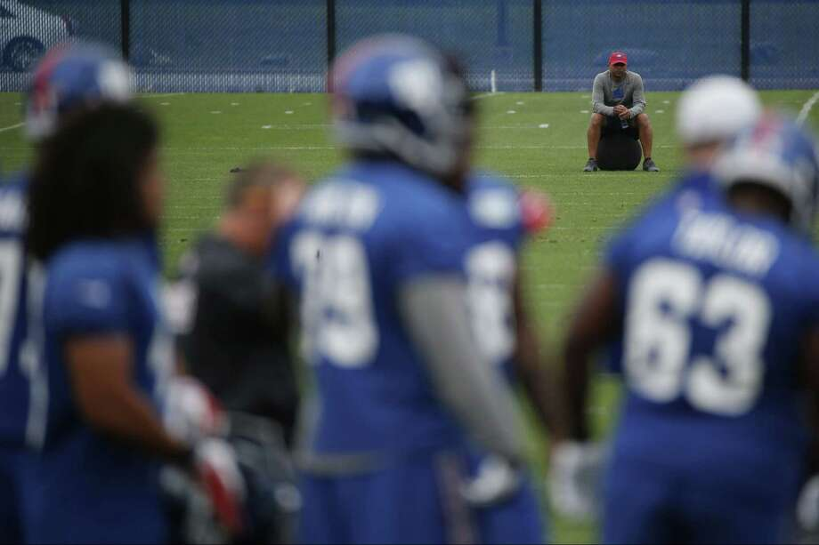 New York Giants general manager Jerry Reese sits on an exercise ball during minicamp Thursday in East Rutherford, N.J. Photo: Julio Cortez — The Associated Press  / AP