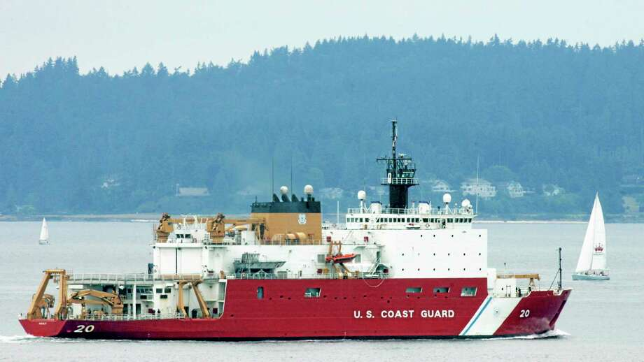 This Aug. 6, 2007, photo shows the U.S. Coast Guard icebreaker Healy leaving Seattle for a scientific mission in the Arctic that will include breaking ice well north of Barrow, Alaska. Photo: Ted S. Warren — The Associated Press  / AP