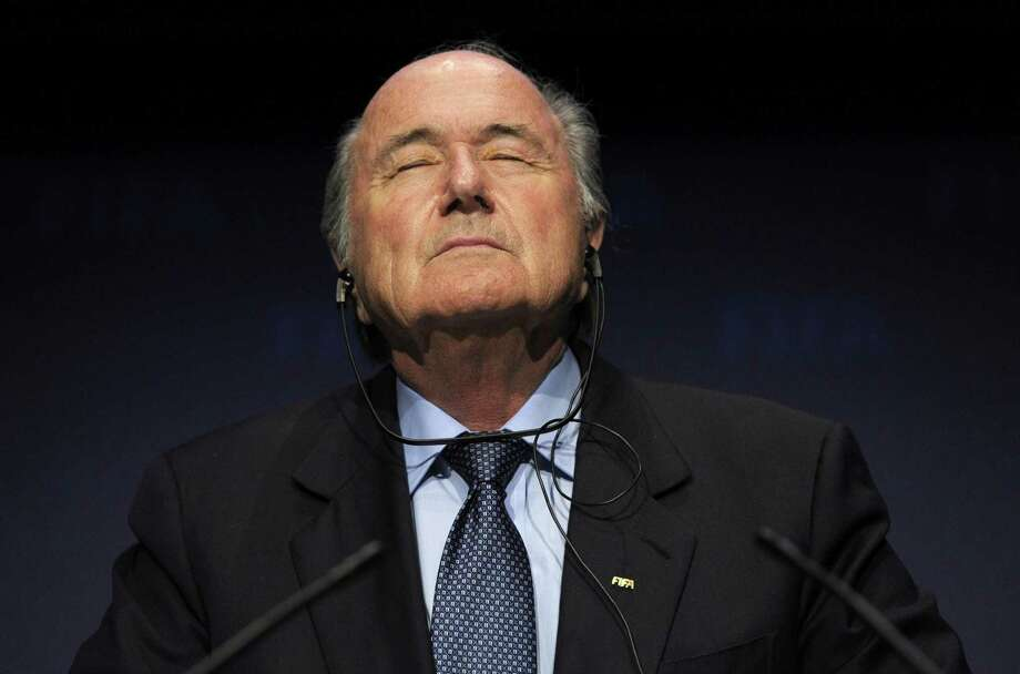 In this Nov. 19, 2010 file photo, FIFA President Sepp Blatter pauses during a press conference. Photo: Steffen Schmidt — The Associated Press File Photo  / AP2010