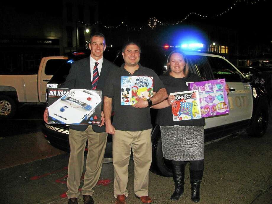 The Middlesex United Way Young Leaders Society offers opportunities for individuals ages 21 to 40 to network, serve and lead. Some of those taking part in the annual Holiday Social & Stuff-a-Cruiser event are shown here. Photo: Courtesy Photo
