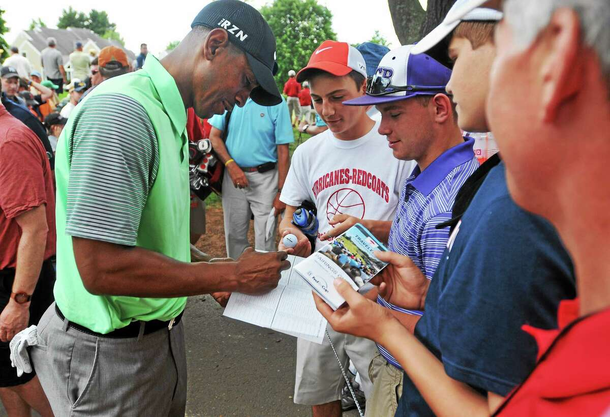 UConn men's basketball coach Kevin Ollie signs autographs during the Travelers Celebrity Pro-Am on Wednesday at TPC River Highlands in Cromwell.