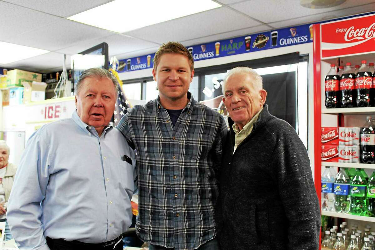 """Kevin """"Dauber"""" Lacz (center), stands with Willowbrook Spirits owner Jay Polke (left) and Chamber President Larry McHugh (right). He was recognized at the chamber's Member Breakfast Meeting on Feb. 6 and appeared at a meet and greet at Willowbrook Spirits on Feb. 7."""