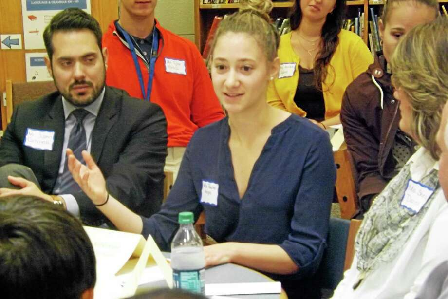 Middletown High School student Rachel Angle spoke at a roundtable Wednesday about childhood hunger and how she and other members of Dragons in Action work to improve food selections and make lunch more nutritious. At her left is Youth Services Coordinator Justin Carbonella. Photo: Robert Mayer — The Middletown Press