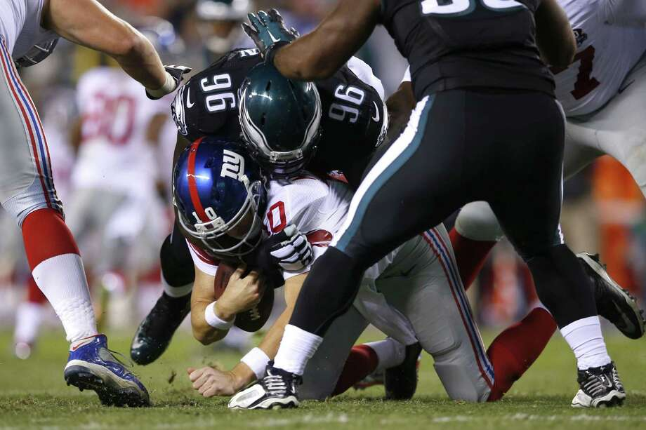 Eagles nose tackle Bennie Logan sacks New York Giants quarterback Eli Manning during the first half of Sunday night's game in Philadelphia. Photo: Michael Perez — The Associated Press  / FR168006 AP