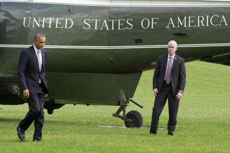 President Barack Obama walks from Marine One on the South Lawn of the White House in Washington on Oct. 14, 2014. Photo: AP Photo/Jacquelyn Martin  / AP