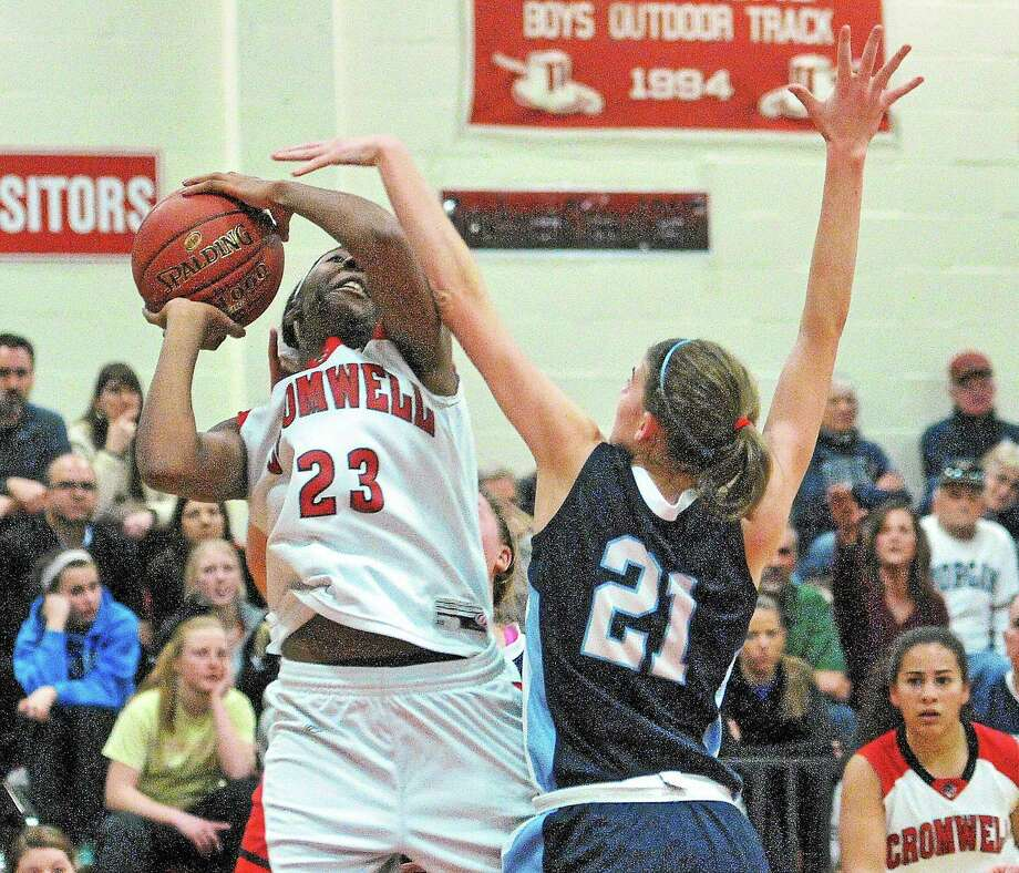 Cromwell's Janelle Harrison puts up a shot as Morgan's Josie Sullivan defends during the second quarter of the SLC Championship. Cromwell won 41-40 in overtime. Photo: Photos By Peter Casolino — New Haven Register