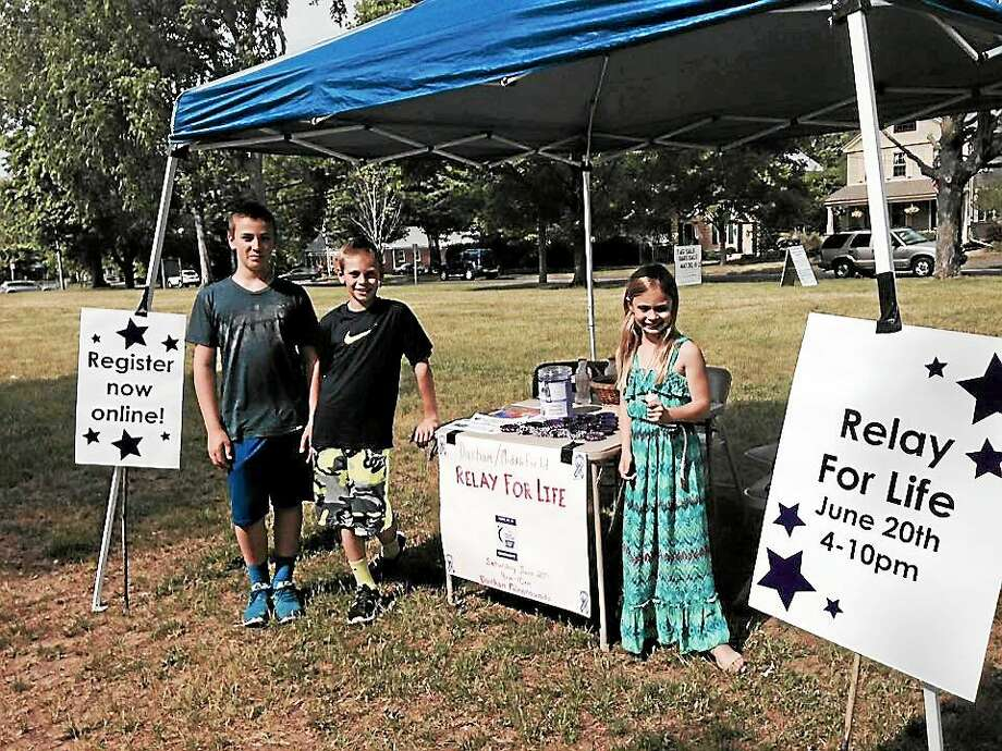 Members of Jason Salley's team sold bracelets recently at the town's Farmer's Market, held Thursdays on the Durham Town Green. The handmade bracelets cost $5. Photo: Courtesy Photo